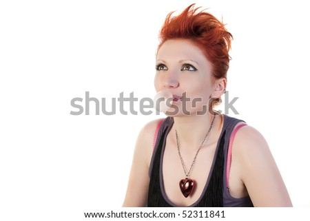 Young redhead woman looking away on a white background
