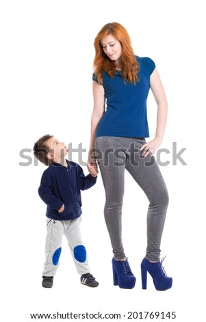 Young redhead woman posing with a nice little boy. Isolated on white - stock photo