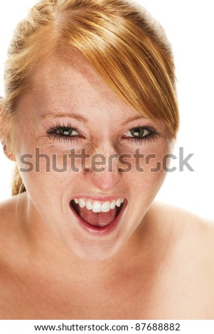 young redhead woman screaming on white background