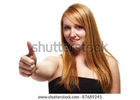 young redhead woman showing thumbs up on white background - stock photo