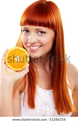 Young redhead woman with orange isolated on white