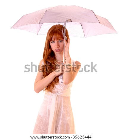 Young redhead woman with umbrella isolated on white - stock photo