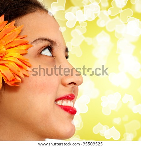 Young Refreshing Face Of A Girl In Sunlight And Yellow Bokeh - stock photo