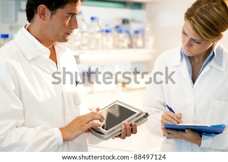 Young researcher using tablet PC - stock photo