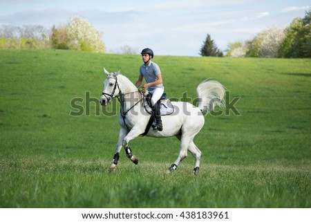 Young rider while training with his horse  - stock photo