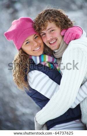 young romance couple wants to kiss in Winter Park - stock photo