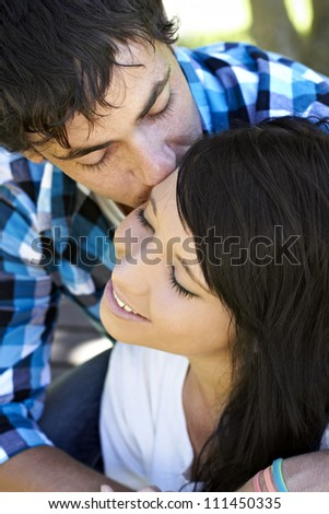 Young romantic couple embrace each other - stock photo