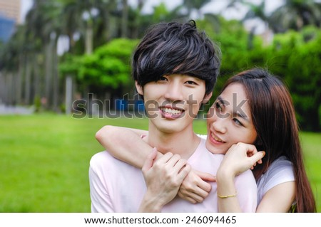 young romantic couple embracing each other - stock photo