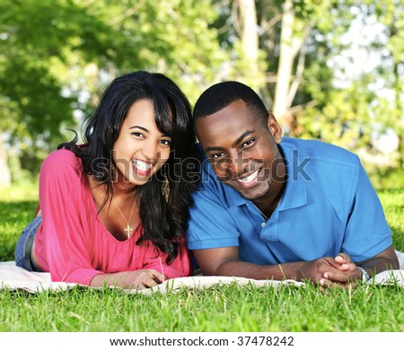 Young romantic couple enjoying summer day in park - stock photo