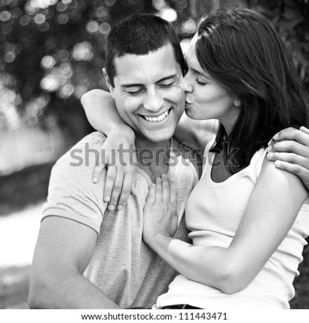 Young romantic couple having fun while kissing and laughing - stock photo