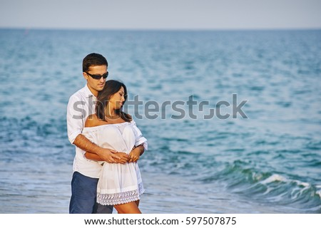 young romantic couple on the sea shore