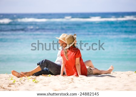 Young romantic couple on white sand beach - stock photo