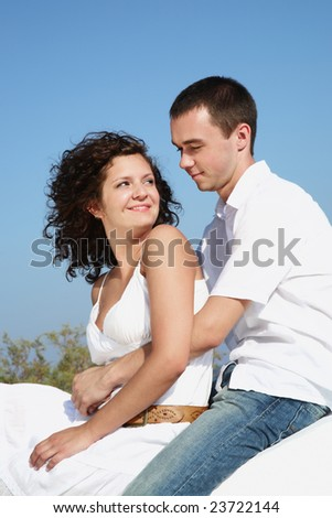 young romantic couple over blue sky background