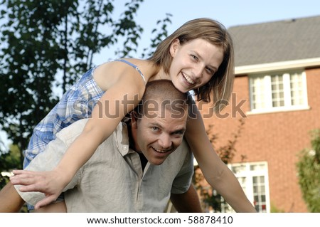 Young romantic couple spends afternoon playing in their garden. - stock photo