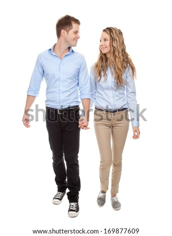 Young romantic couple walking, isolated on white - stock photo