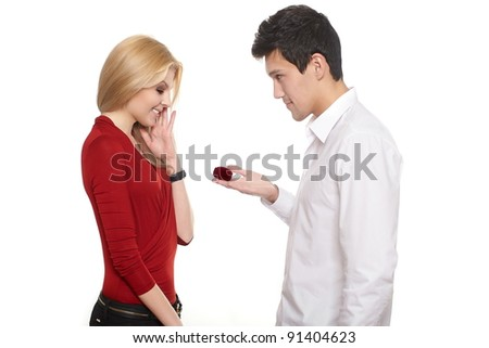 young romantic handsome man presenting jewelry in red attractive case to girl,isolated on white st valentine - stock photo