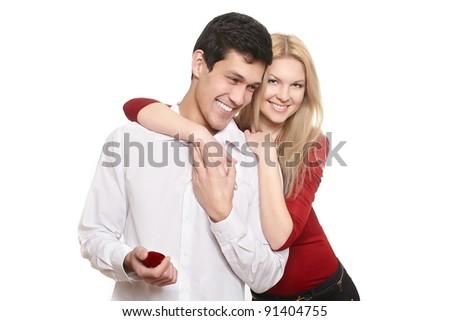 young romantic handsome man presenting jewelry in red attractive case to girl,isolated on white st valentine smiling couple - stock photo