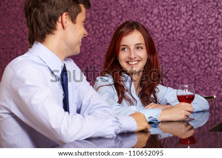 young romantic happy smiling couple drink wine in restaurant - stock photo