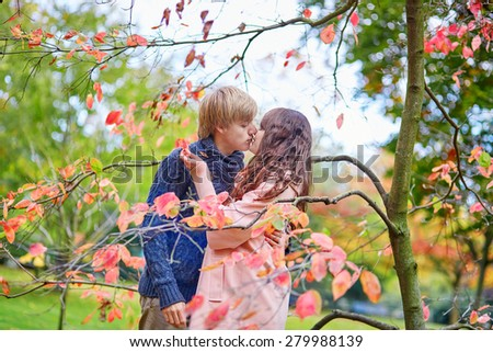 Young romantic loving couple in Paris, dating and enjoying nice autumn day together - stock photo