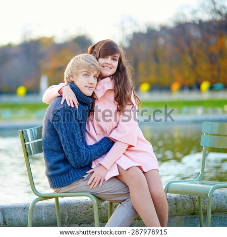 Young romantic loving couple in Paris, dating and enjoying nice autumn day together