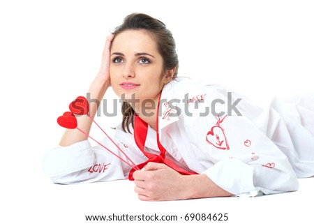 young romantic woman in white shirt and holds two hearts, studio shoot isolated on white - stock photo