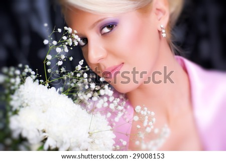 Young romantic woman with flowers portrait. Selective focus effect. Focus on center. - stock photo