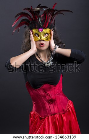 Young romany woman wonder on carnaval with mask