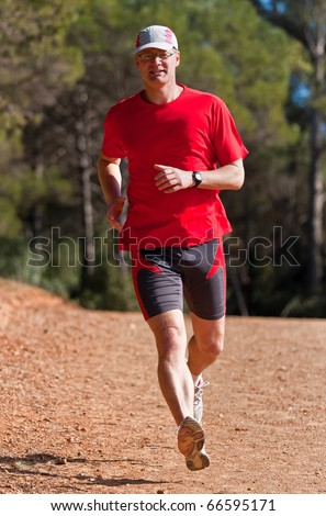 Young runner while training for a competition - stock photo