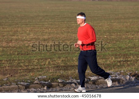 Young runner while training for a competition in winter - stock photo