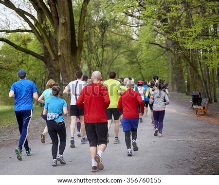 Young runners in the spring park - stock photo
