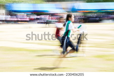 Young runners with panning and motion blur effect - stock photo