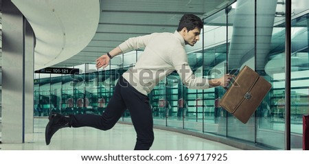 Young running businessman - stock photo