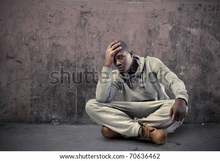 Young sad african man - stock photo