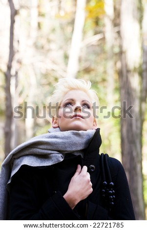 Young sad beauty in nature background - stock photo