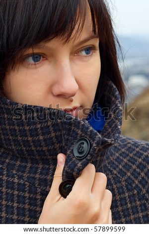 Young sad woman outdoor portrait. - stock photo