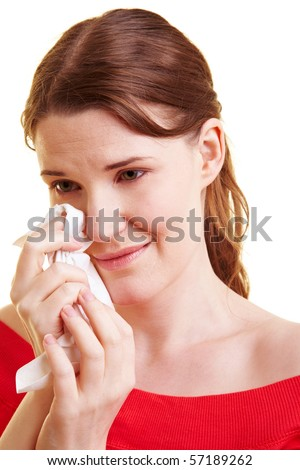Young sad woman with handkerchief drying her tears