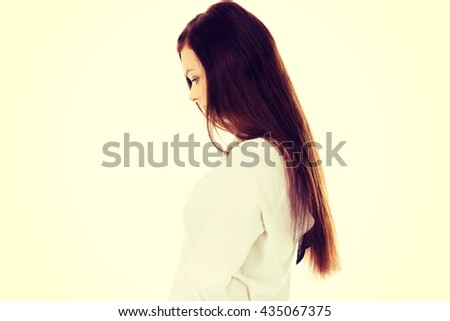 Young sad woman with her head down - stock photo