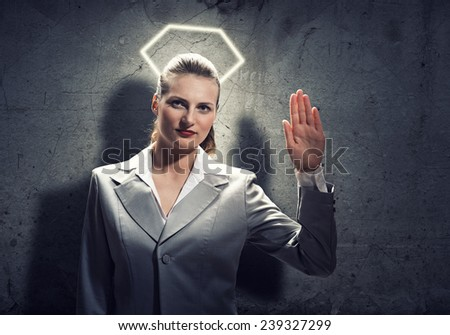 Young saint businesswoman with halo above head