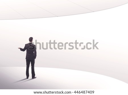 Young sales business person in elegant suit standing with his back in empty white space background with curved lines concept - stock photo