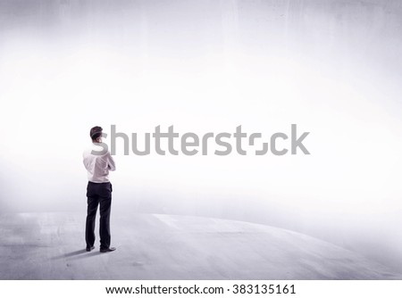 Young sales businessman in elegant suit standing with his back in empty white space background concept - stock photo