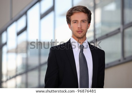 Young salesman in smart suit - stock photo