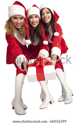 Young Santas presenting a gift box isolated on white - stock photo