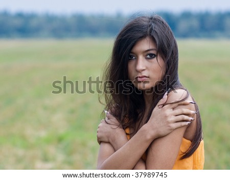 Young scared and frozen woman - stock photo