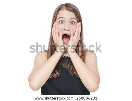 Young scared teenage girl covering her mouth with hand isolated on white background - stock photo