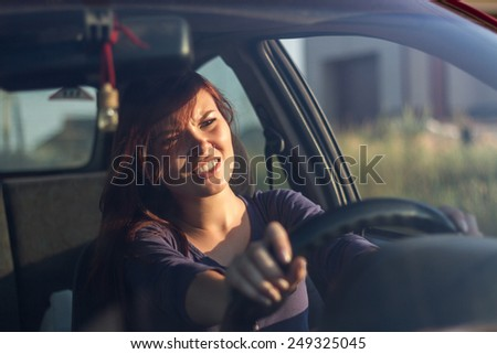 Young scared woman behind the wheel brakes. The woman behind the wheel of a concept. Dangerous driving concept - stock photo
