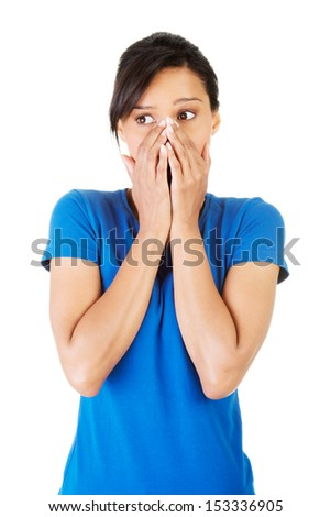 Young scared woman covering the mouth. Isolated on the white background.  - stock photo