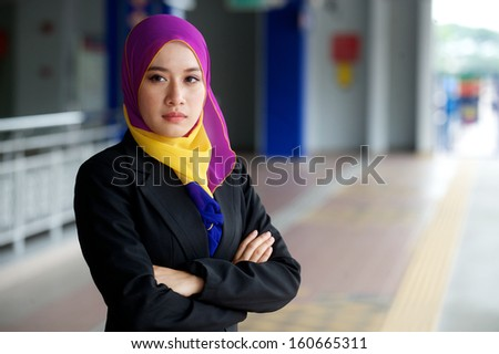Young scarf girl waiting train - stock photo