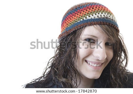 Young school age woman wearing a beanie - stock photo