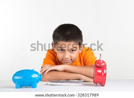 Young school boy and sitting at desk - stock photo