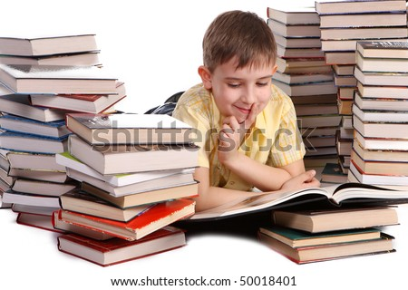 young school boy reading books - stock photo